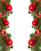 Border of red christmas garland with baubles and ribbons on white. — Stock Photo