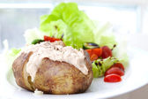 Baked jacket potato with tuna and fresh salad — Stock Photo