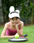 Young girl with tennis racket in outdoor park — Foto Stock