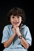 Young boy with both hands begging and pleading with his eyes. — Stock Photo