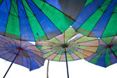 Colorful parasols on a tropical beach. — Stock Photo