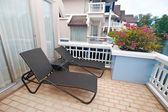 Sunbed on a tropical terrace balcony — Stock Photo