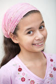 Young Eurasian girl in pink bandanna with a lovely smile — Stock Photo