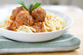 Delicious meatball with spaghetti in tomato sauce — Stock Photo