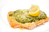 Salmon steak with basil pesto and breadcrumbs sprinkled with parmesan cheese — Stock Photo