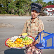 A young lady sells fresh fruit  — ストック写真
