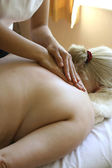Woman receiving a back massage — Stock Photo
