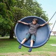 Young boy in playground swing — Stock Photo