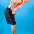 Young fit man with exercise stretch band — Stock Photo #20694279