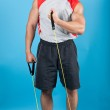 Young fit man with exercise stretch band — Stock Photo #20694337