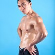 Young fit and muscular Asian man in black denim — Stock Photo #20694341