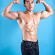 Young fit and muscular Asian man in black denim — Stock Photo #20694359