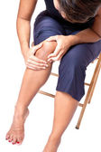 Young woman suffering from knee pain — Stock Photo