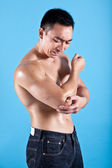 Young fit man suffering from painful elbow injury — Stock Photo