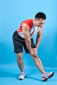 Young fit man doing hamstring stretch — Stock Photo