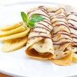 Delicious crepe with banana filling with chocolate sauce - Stock Photo
