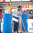TOA PAYOH, SINGAPORE - MARCH 24 : Contender for Strongman  Yusri Bin Ali attempts the 300kg Yoke walk in the Strongman Challenge 2012 on March 24, in Toa Payoh Hub, Singapore. — Stock Photo