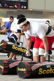 TOA PAYOH, SINGAPORE - MARCH 24 : Contender for Strongman Benjamin Soh attempts the 2 times 120 log walk in the Strongman Challenge 2012 on March 24, in Toa Payoh Hub, Singapore. — 图库照片