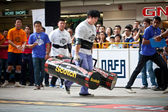 TOA PAYOH, SINGAPORE - MARCH 24 : Contender for Strongman Samuel Lim attempts the 2 times 120 log walk in the Strongman Challenge 2012 on March 24, in Toa Payoh Hub, Singapore. — Stock Photo