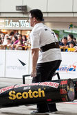 TOA PAYOH, SINGAPORE - MARCH 24 : Contender for Strongman Lloyd Lee approaching finishing line the 2 times 120 log walk in the Strongman Challenge 2012 on March 24, in Toa Payoh Hub, Singapore. — Stock Photo