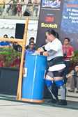 TOA PAYOH, SINGAPORE - MARCH 24 : Contender for Strongman Keith Wong in his 300kg yoke walk in the Strongman Challenge 2012 on March 24, in Toa Payoh Hub, Singapore. — Stock Photo
