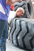 TOA PAYOH, SINGAPORE - MARCH 24 : Contender for Strongman Sulaiman Ismail attempting the six times 350kg tyre flip category in the Strongman Challenge 2012 on March 24, in Toa Payoh Hub, Singapore. — Stock Photo