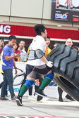 TOA PAYOH, SINGAPORE - MARCH 24 : Contender for Strongman Samuel Lim attempting the six times 350kg tyre flip category in the Strongman Challenge 2012 on March 24, in Toa Payoh Hub, Singapore. — Stock Photo