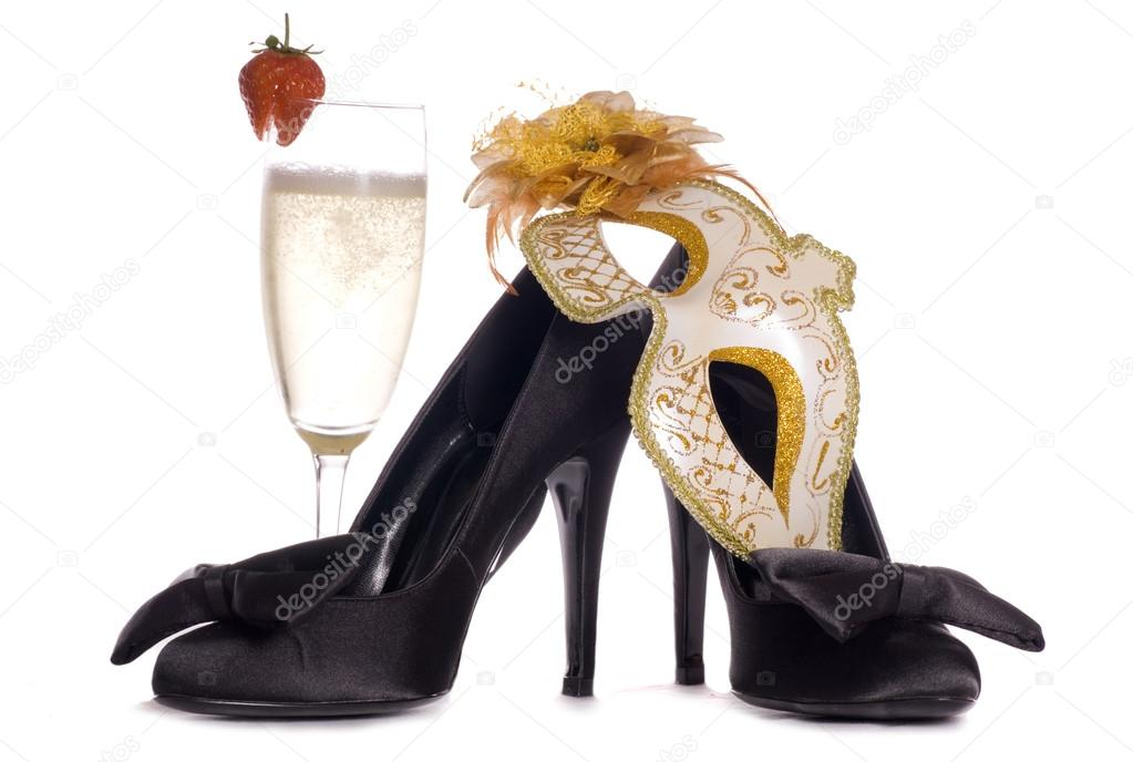 Masquerade mask with high heels and champagne cutout  Stock Photo #12487911