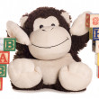 Baby shower with soft toy monkey — Stock Photo
