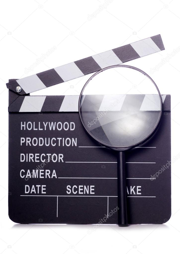 Film clapper board with magnifying glass studio cutout  Stock Photo #19584911