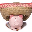 Piggy bank wearing a sombrero cutout — Stock Photo