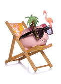 Saving for a holiday piggy bank cut out — Stockfoto