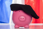 Piggy bank on a french flag — Stock Photo
