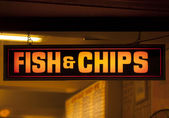 Fish and chip shop neon sign — Stock Photo