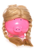 Piggybank wearing a girls wig — Stock Photo