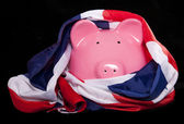 Piggy bank with union jack flag — Stock Photo