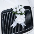 White wedding flowers on a car — Stock Photo #34794711