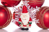 Father christmas figure with baubles — Stockfoto