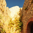 Ancient walls of a fortress shined with the evening sun — Stock Photo