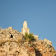 Ancient defensive tower at mountain top — Stock Photo