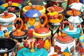 Multi colored clay jugs — Stock Photo