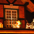 Stock Photo: Christmas decorations on roof of house