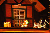 Christmas decorations on the roof of the house — Fotografia Stock
