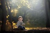 Little boy in forest — Stock Photo