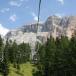 Chair lift up towards the top of the Dolomites — Stock Photo