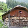 Typical South Tyrolean House with flower and pitched roof — Stock Photo #12486946