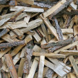 Foto de Stock  : Pieces of wood cut from lumberjack to warm up