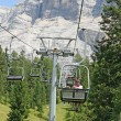 Chair lift up towards the top of the Dolomites - Stock Photo