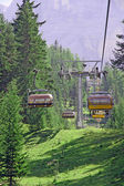 Chair lift up to the top of the mountain — Stock Photo