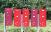 Group letterboxes in the middle of the Woods — Stock Photo